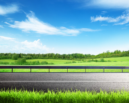 rural roads: road and spring grass Stock Photo