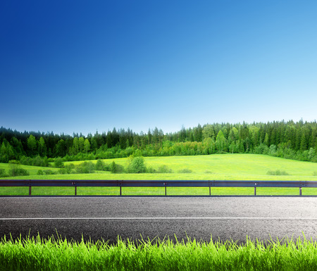 road and spring grass Stock Photo
