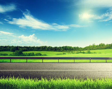 rural road: road and spring grass Stock Photo