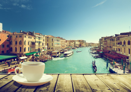 coffee on table and Venice in sunset time, Italy 에디토리얼