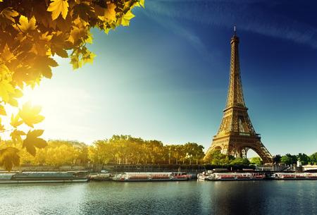 Seine in Paris with Eiffel tower in autumn season photo