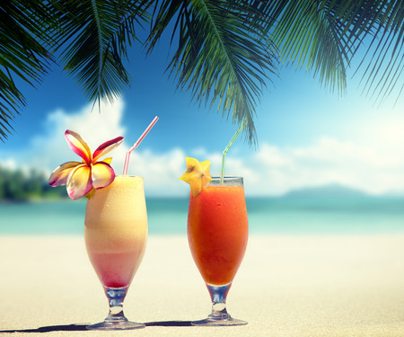 mangoes: fresh fruit juices on a tropical beach Stock Photo