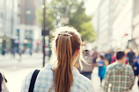 young woman on street of London photo