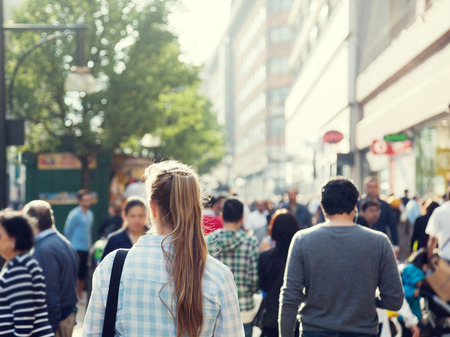 crowd: young woman on street of London Stock Photo