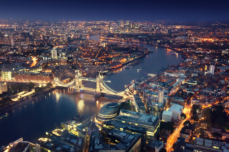 city of london: London at night with urban architectures and Tower Bridge