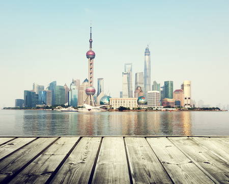 wooden dock: Shanghai skyline and wooden platform Stock Photo