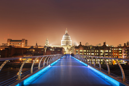 millennium bridge: St. Paul Cathedral and millennium bridge, London , UK Editorial