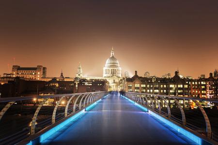 millennium: St. Paul Cathedral and millennium bridge, London , UK Editorial
