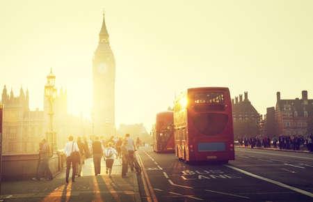 people on Westminster Bridge at sunset, London, UK photo