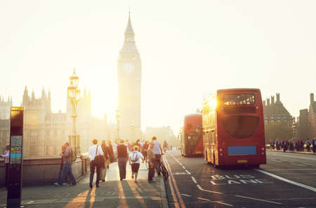 government: people on Westminster Bridge at sunset, London, UK