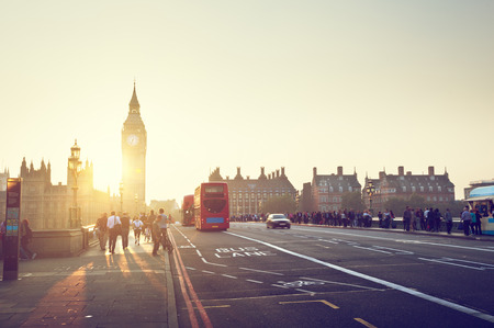 uk: people on Westminster Bridge at sunset, London, UK