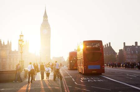 london people: people on Westminster Bridge at sunset, London, UK