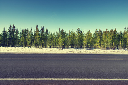 country side: road in winter forest Stock Photo
