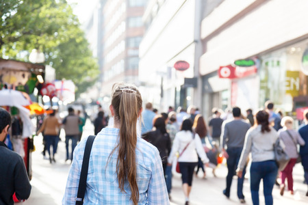 crowded: young woman on street of London Stock Photo