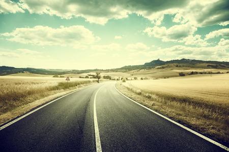 seson: asphalt road in Tuscany Italy