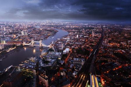 skyline at sunrise: London aerial view with  Tower Bridge in sunset time