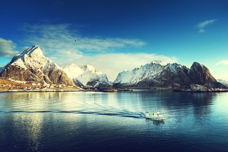 sea fishing: snow in Reine Village, Lofoten Islands, Norway Stock Photo