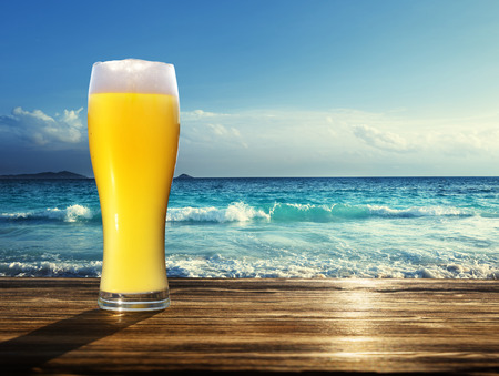 fresh  unfiltered beer and tropical beach