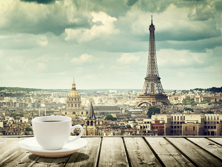 drink coffee: background with cup of coffee and Eiffel tower in Paris