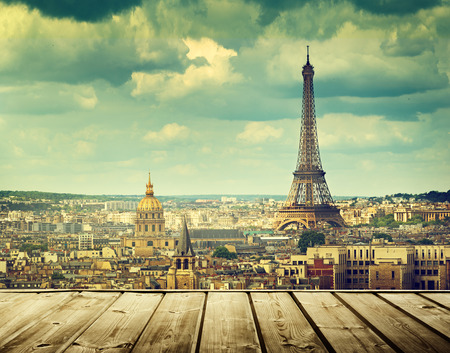 deck: background with wooden deck table and Eiffel tower in Paris