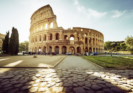 rome: Colosseum in Rome and morning sun, Italy