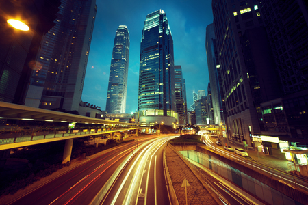 city buildings: traffic in Hong Kong at sunset time Stock Photo