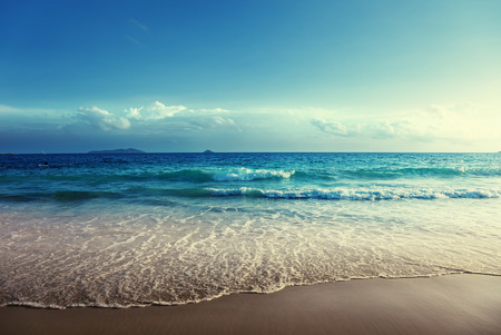 water waves: seychelles beach in sunset time Stock Photo