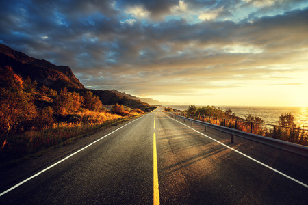 sunrise mountain: road by the sea in sunrise time,  Lofoten island, Norway Stock Photo
