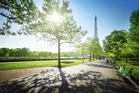 sunny morning and Eiffel Tower, Paris, France Фото со стока