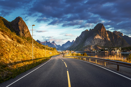 road by the sea in sunrise time,  Lofoten island, Norway 스톡 콘텐츠