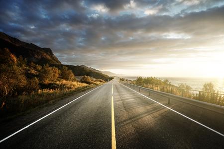 guardrail: road by the sea in sunrise time,  Lofoten island, Norway Stock Photo
