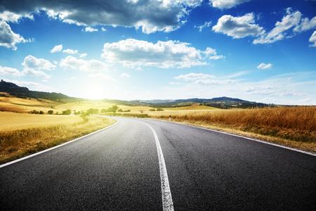scenic: asphalt road in Tuscany, Italy