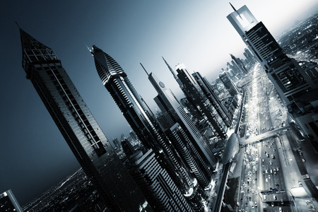 futuristic city: Dubai skyline in sunset time, United Arab Emirates Stock Photo