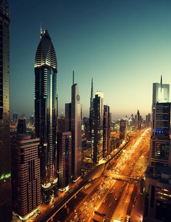 sunset city: Dubai skyline in sunset time, United Arab Emirates Stock Photo