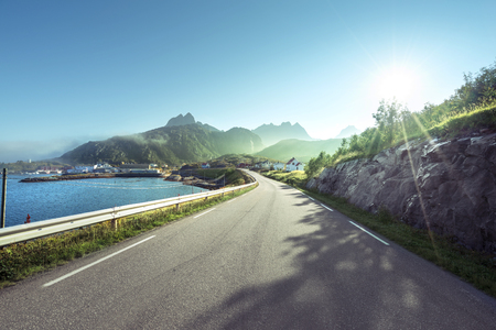 blue sea: road and mist, Lofoten islands, Norway