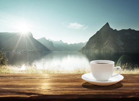 cielo con nubes: cup of coffee and sunset in Norway, Lofoten islands Foto de archivo