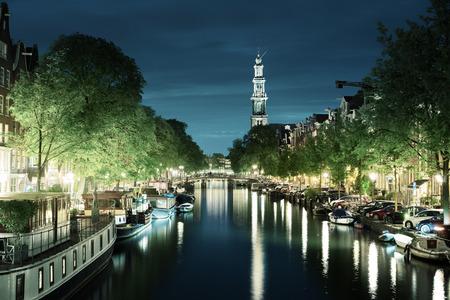westerkerk: Westerkerk church tower at canal in  Amsterdam, Netherlands Stock Photo