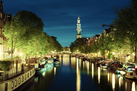 Westerkerk church tower at canal in  Amsterdam, Netherlands Stock Photo