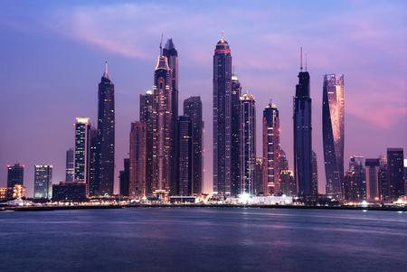marina water: panorama of skyscrapers in Dubai Marina, sunset time, UAE Stock Photo