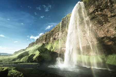 water flow: Seljalandsfoss waterfall at sunset, Iceland