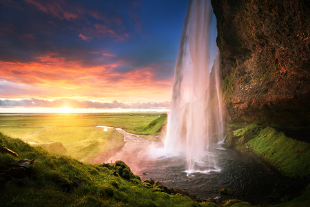 cliffs: Seljalandsfoss waterfall at sunset, Iceland