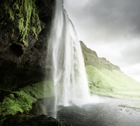 water flow: Seljalandfoss waterfall in summer time, Iceland
