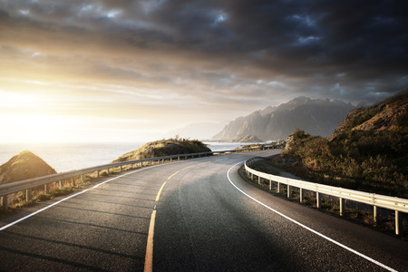 country road: oad by the sea in sunrise time, Lofoten island, Norway