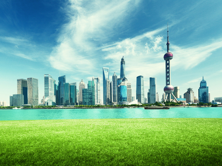 Shanghai skyline and green grass in park, China Stock Photo