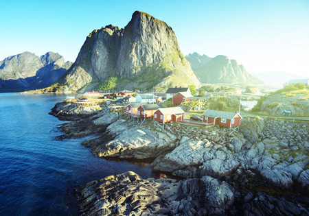 island: Fishing hut at summer time - Reine, Lofoten islands, Norway