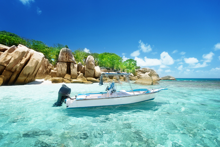 la digue: speed boat on the beach of Coco Island, Seychelles