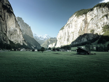 Lauterbrunnen and Swiss Alps in the background, Berner Oberland, Switzerland, Europe Stock Photo