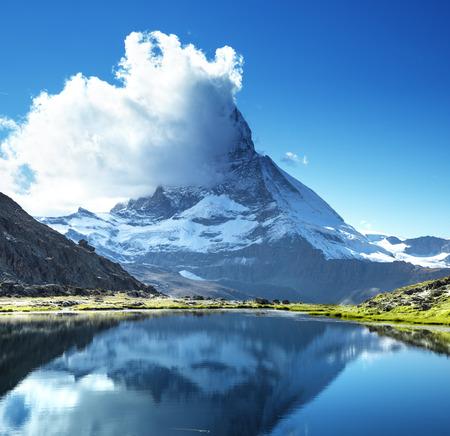 Reflection of Matterhorn in lake Riffelsee, Zermatt, Switzerland Stock Photo