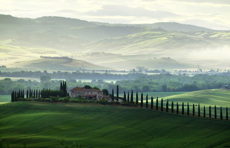 Tuscany countryside panorama, green field and farm house, Italy Stock Photo - 96173526