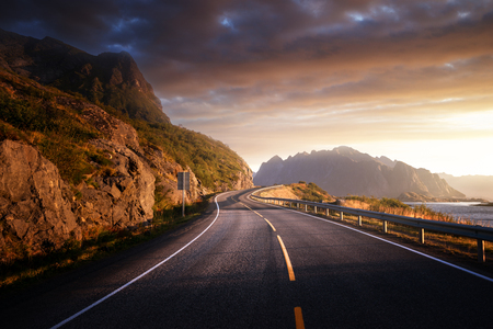road by the sea in sunrise time, Lofoten island, Norway Stock Photo - 113835272